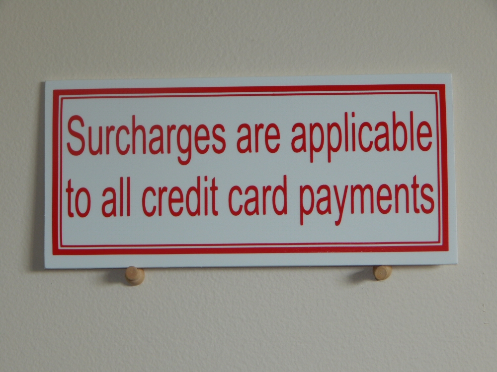 Can Merchants Charge You Extra For Swiping Your Card Instead Of ...